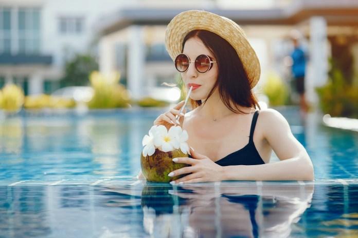 brunette girl drinking coconut juice