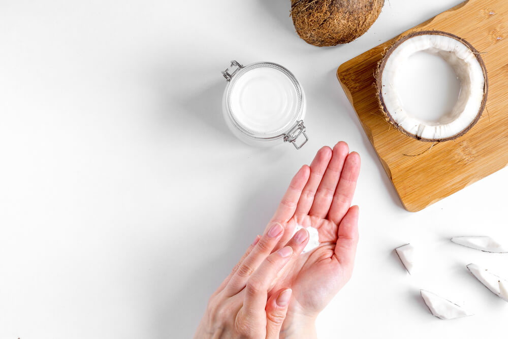 person pouring Coconut Oil Ointment