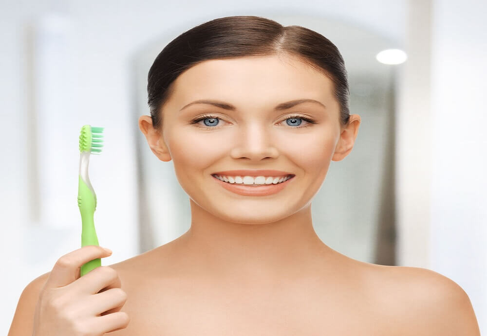 tea tree oil with toothbrush