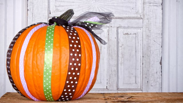 Pumpkin wrapped with ribbons