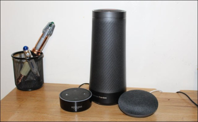 An Amazon Echo, Google Home Mini and Harmon Kardon Invoke (Cortana speaker)