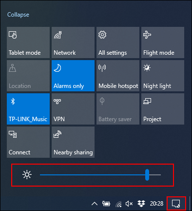 Click and move the Brightness slider to the left to decrease the brightness of the screen.