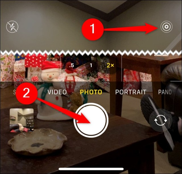 Apple iPhone Activate Live Photo, then press the shutter button