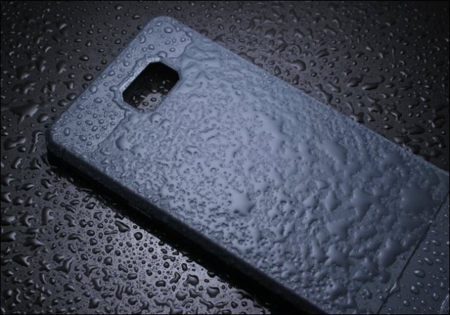 A smartphone case covered with water.