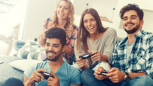 A group of friends playing games in beautifully bright lighting.