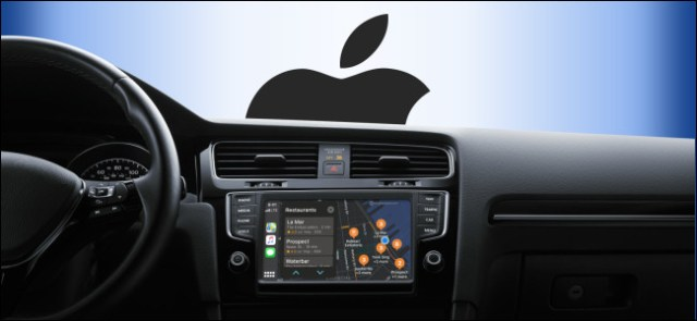 A CarPlay Infotainment dashboard in a car with the Apple logo out the window.