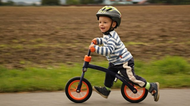A child on a balance bike