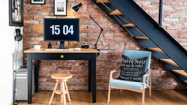 Compact home office nestled under a staircase