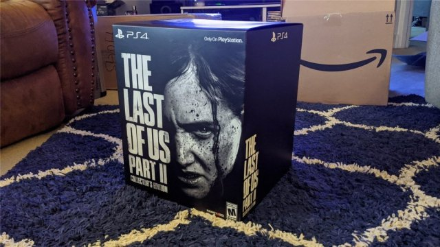 The Last of Us Part II Collector's Edition on a blue carpet
