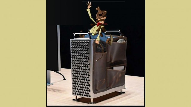 A cowboy on the WaterField Mac Pro Gear saddle like a horse.