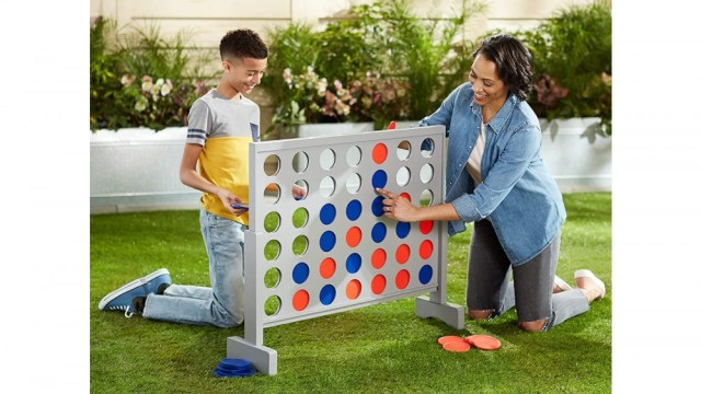 Giant Connect four outdoor set with adult and child playing together