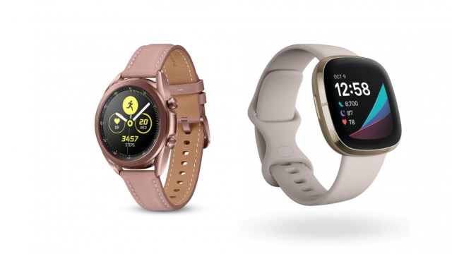 A Galaxy Watch3 and FItbit Sense side by side.
