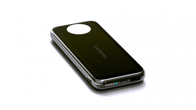 A close-up of the Satechi wireless power bank showing an Apple Watch charger.