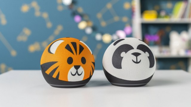 Two echo dots with tiger and panda blanket.