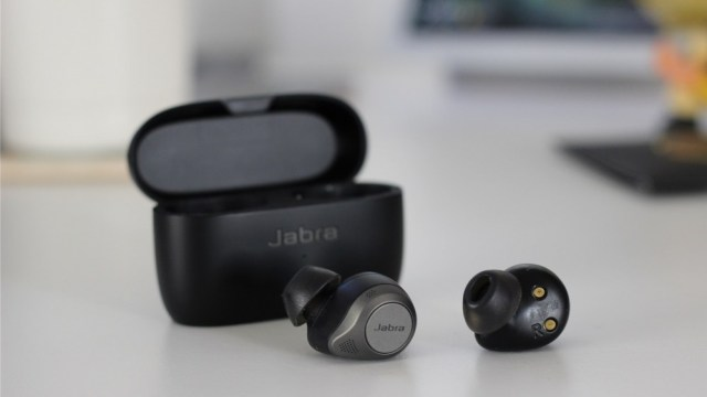 Elite 85t earphones pop out of the case, showing the buttons and eartip
