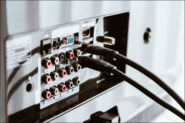 HDMI cables connected to the back of a TV.