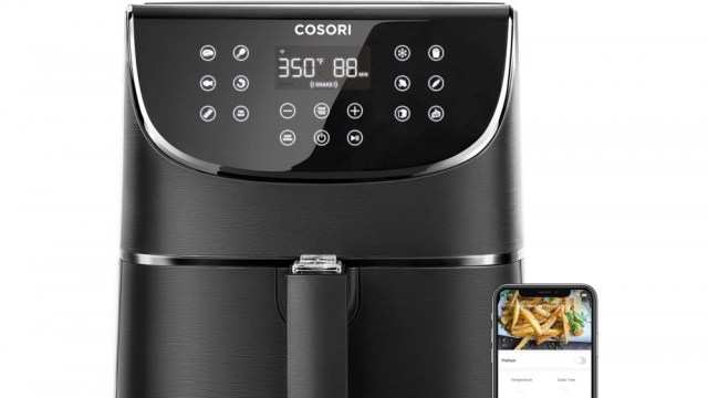 COSORI Smart Air Fryer next to smartphone with companion app for air fryer