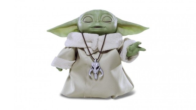An animatronic baby Yoda with closed eyes and stood up, as if using the Force.
