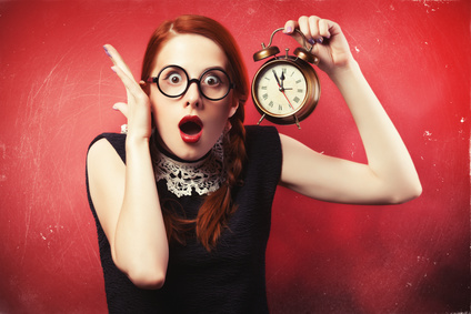 For her too, Time is Money. Redhead girl with clock.