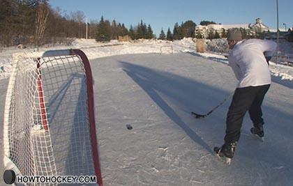 how to take a back hand shot in hockey