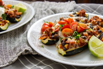 Turkey taco stuffed zucchini boats on a plate
