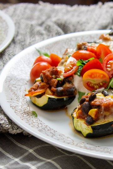 Turkey taco stuffed zucchini boats on a plate