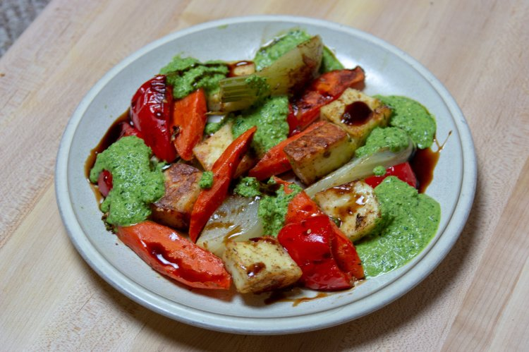 Roasted veggies and cubed paneer with spinach walnut pesto and pomegranate molasses.