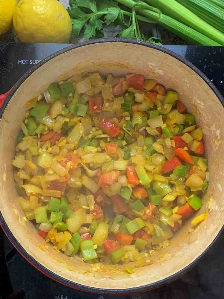 vegetables sweating in a dutch oven