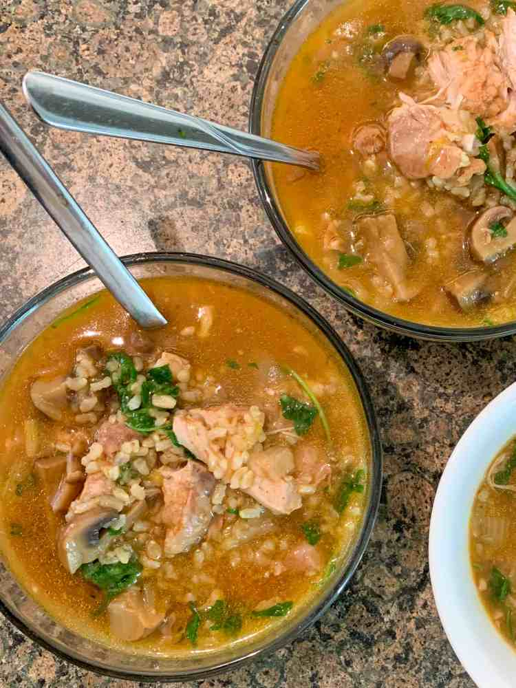 three bowls of chicken and brown rice stew