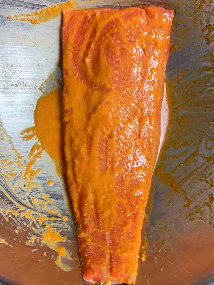 a fillet of salmon dressed in spicy citrus dressing