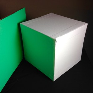White Cube with Green Reflected Light. You may think the cube is white but it is clearly green on one side.