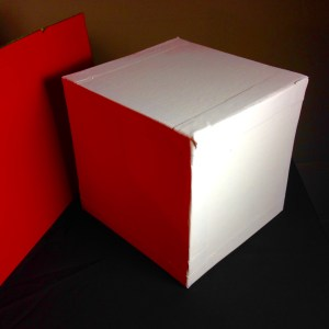 White Cube with Red Reflected Light. You may think the cube is white but it isn't white if a color is reflecting on it.