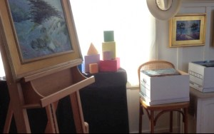 Studio with easel and color blocks at window