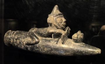 Moche fisherman riding caballito de totora
