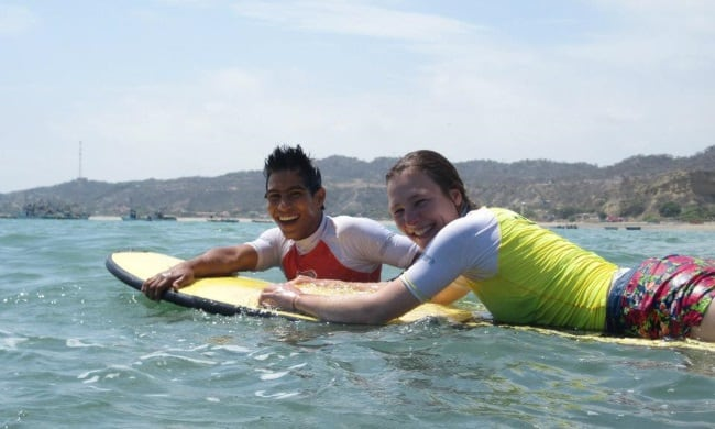 Learning to surf in Zorritos, Peru.