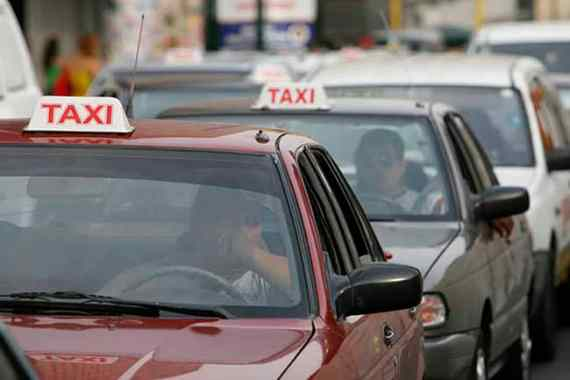 Taxis waiting in traffic