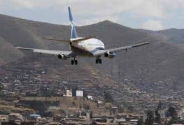 cusco airport guide - plane landing at cusco airport
