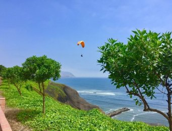 Paragliding over coast in Miraflores Lima Peru