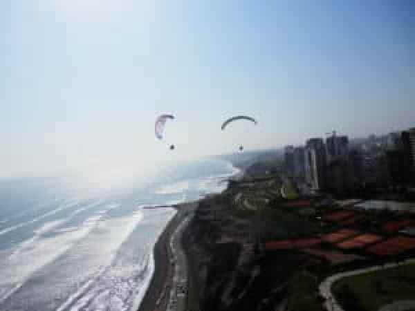 People paragliding Lima on the Miraflores green coast