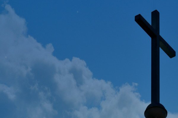 Picture of cross against the clouds taken by Alan Ballou copyright 2014