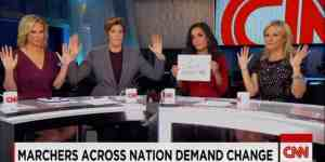 """CNN anchors do the """"Hands Up, Don't Shoot"""" sign based upon a lie told by a friend of thug and strong-arm robber Michael Brown."""