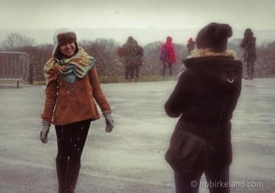 Tourist Enjoying the falling snow in Edinburgh, Scotland.