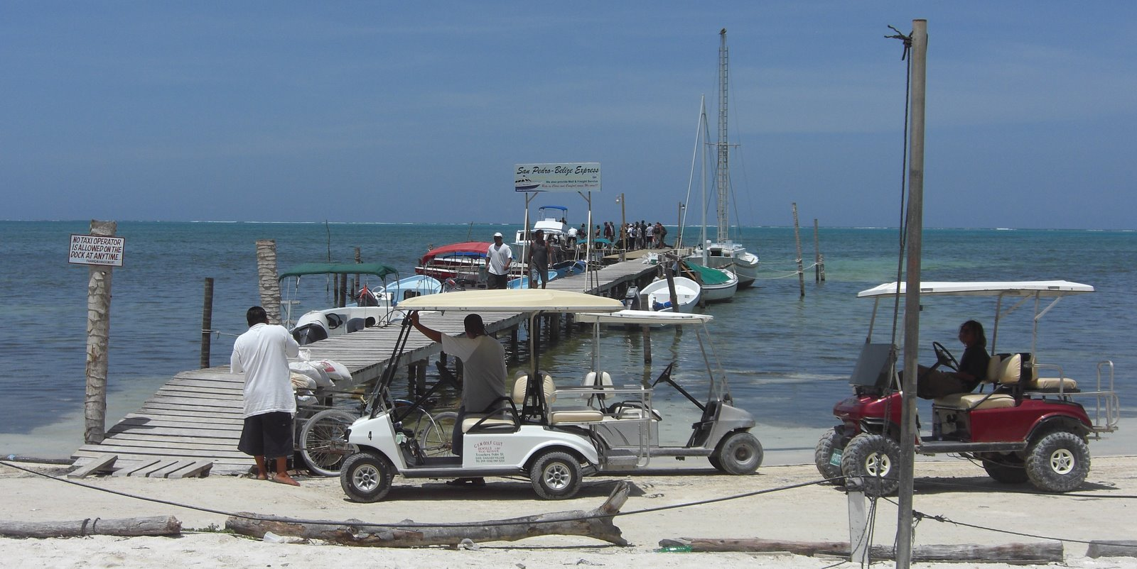 Golf cart taxis on the prowl for the newly arrived boat!