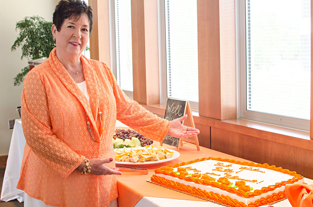 Betty Drinnen and her orange and white retirement cake