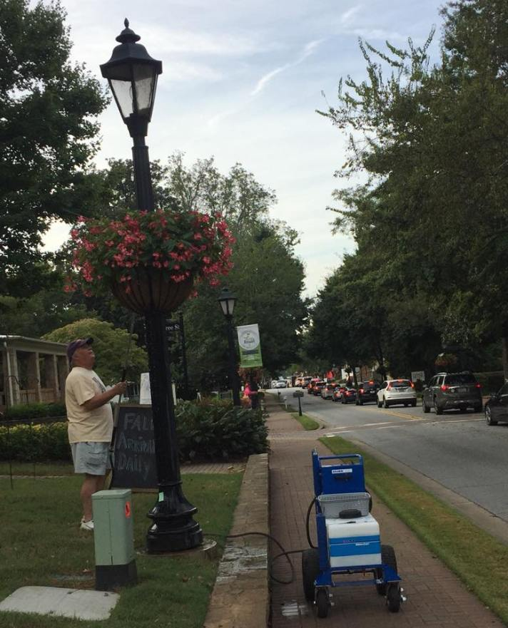 Volunteer with the HRBP Watering Brigade on Canton St. Photo courtesy of Liz Jackson.