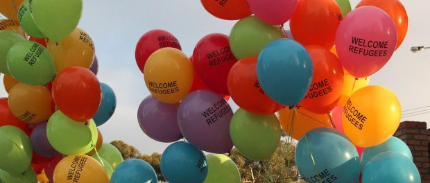 Balloons with words refugees welcome on them