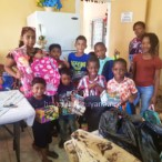 Children being gifted toys and school material at the Lusignan Health Center