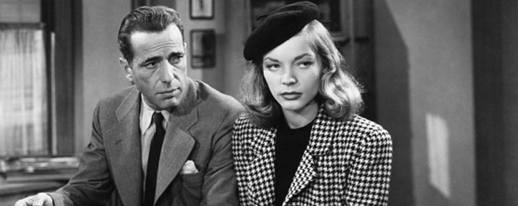 Humphrey Bogart and Lauren Bacall sniffing out scams