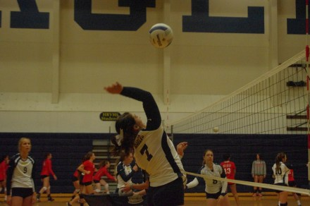 Kaylin Winans spikes the ball for a point for her team.