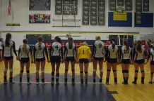 The HRV Girls' Volleyball Team stands for the national anthem